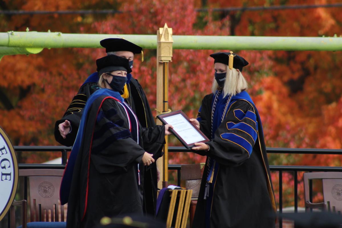 Meredith Clark-Wiltz accepts faculty award for Allison Fetter-Harrott