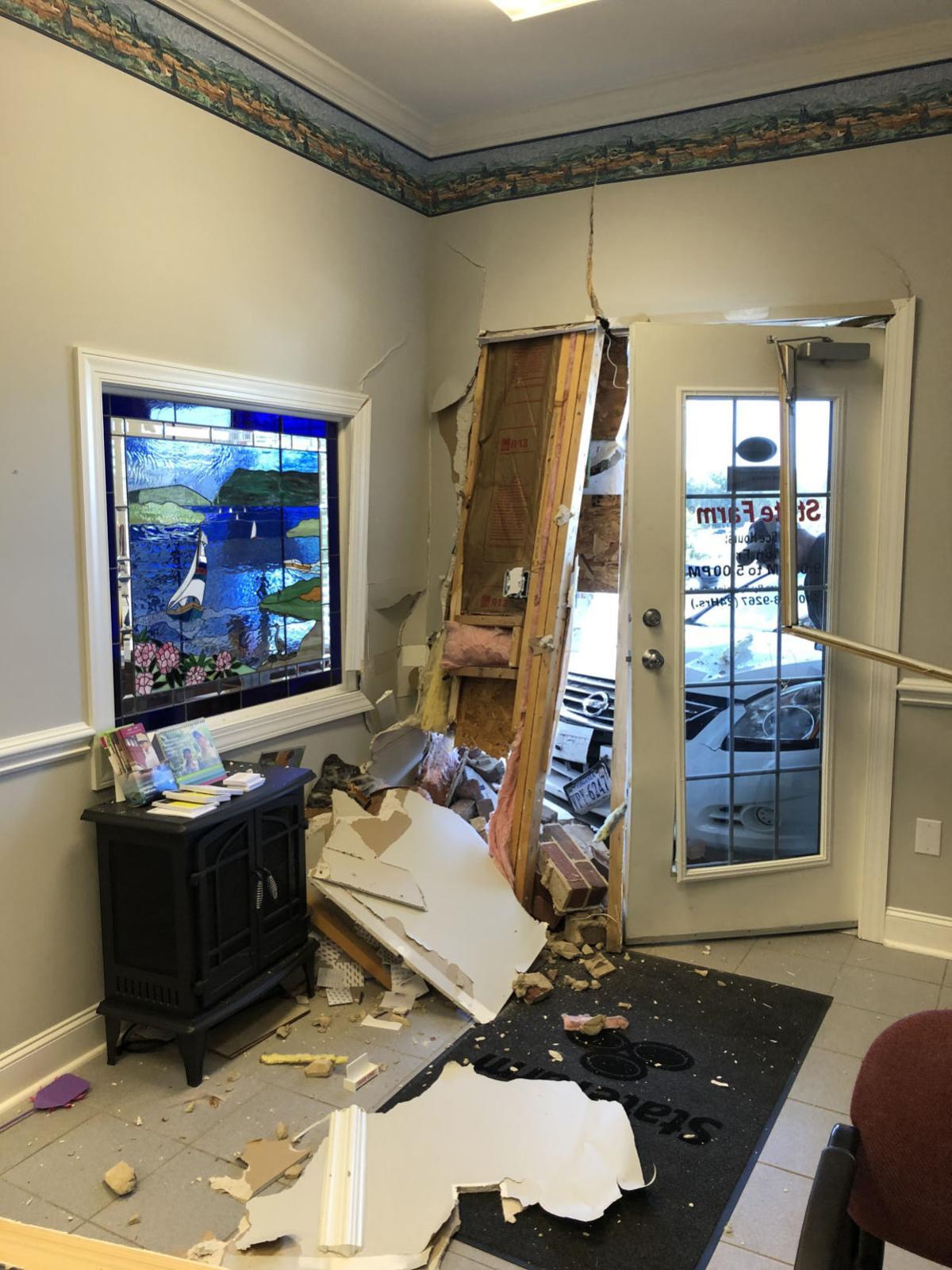 Insurance office sustains damage after crash