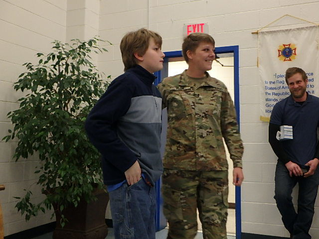 Soldier reunites with son