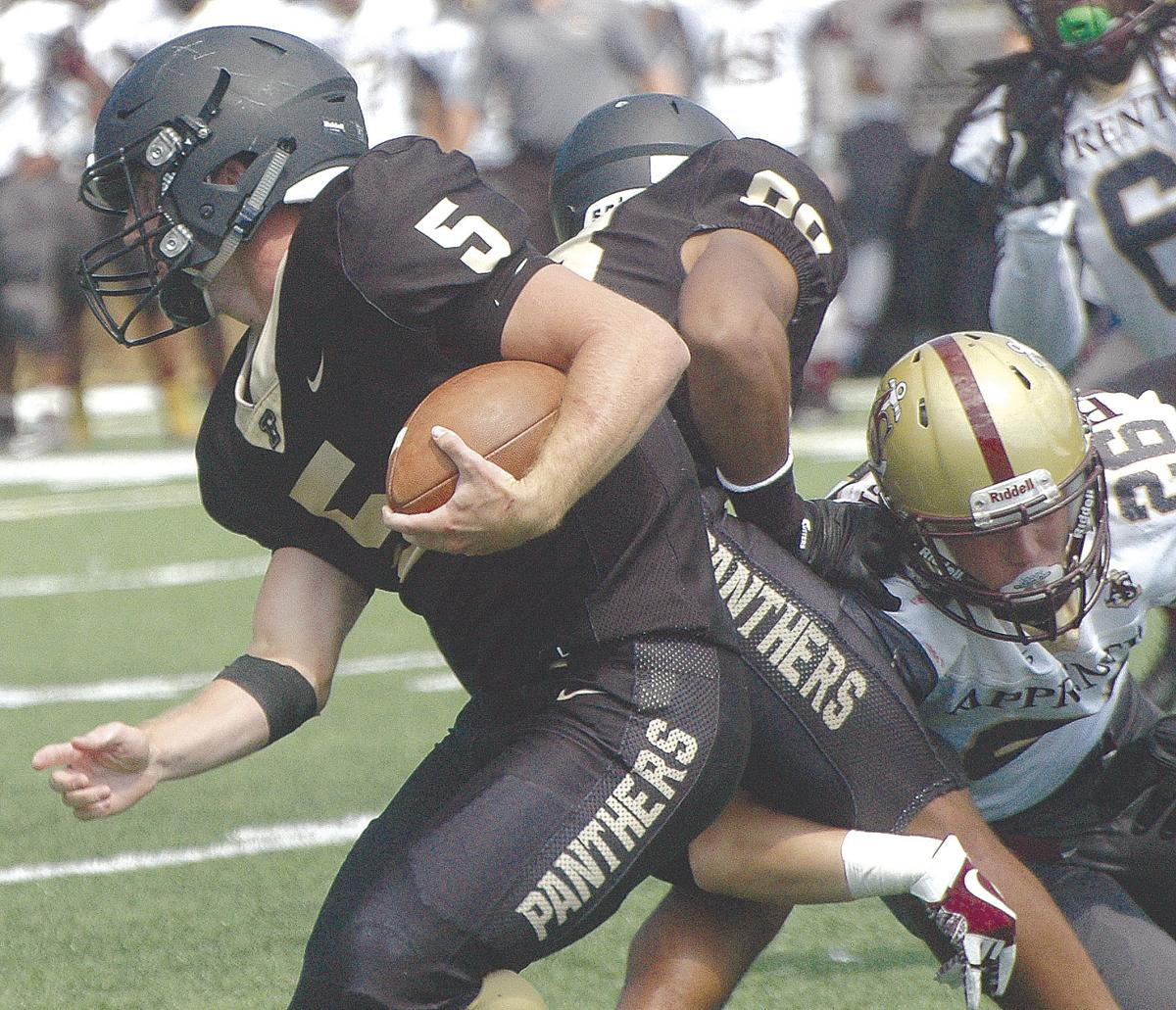 Ferrum college sophomore running back returnman brian mann 5 uses a block from a teammate to break free of a would be apprentice school tackler during the