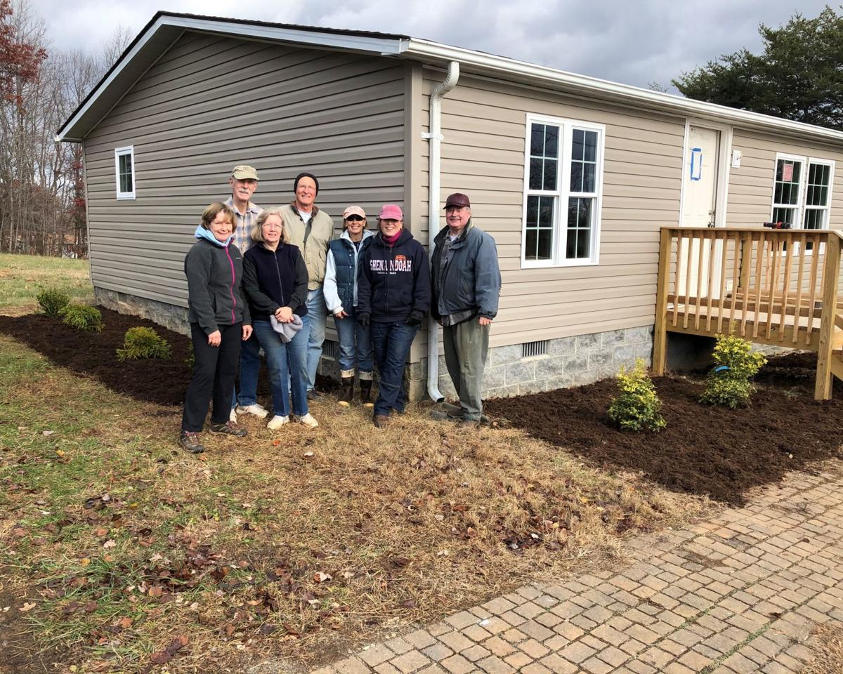 Volunteers help make a house a home with landscaping