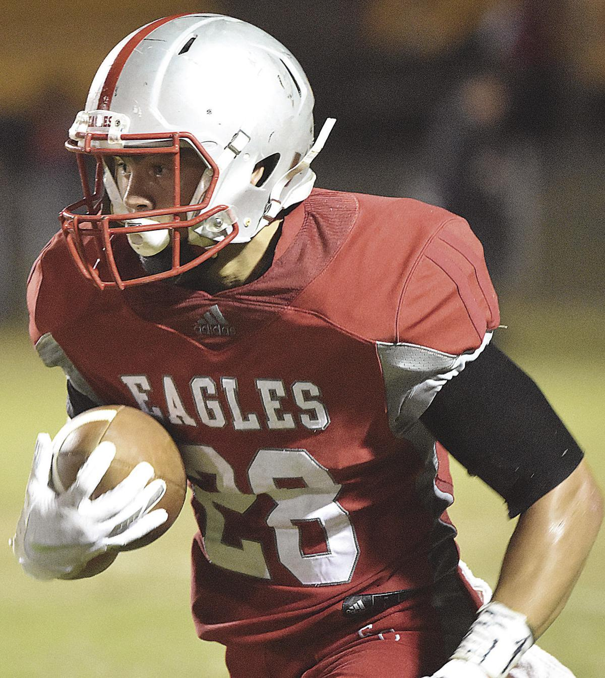 Eagles take winning streak into district play, down Titans, 31-14