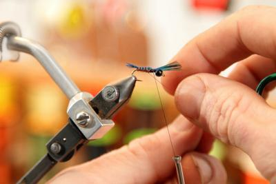 A closeup image of a freshly tied fly (fishing lure)