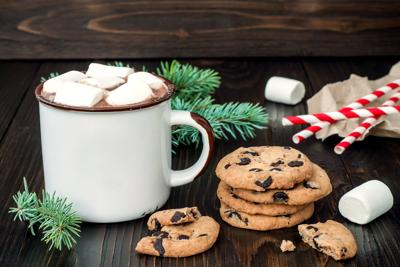 Hot chocolate with marshmallows and chocolate chip cookies
