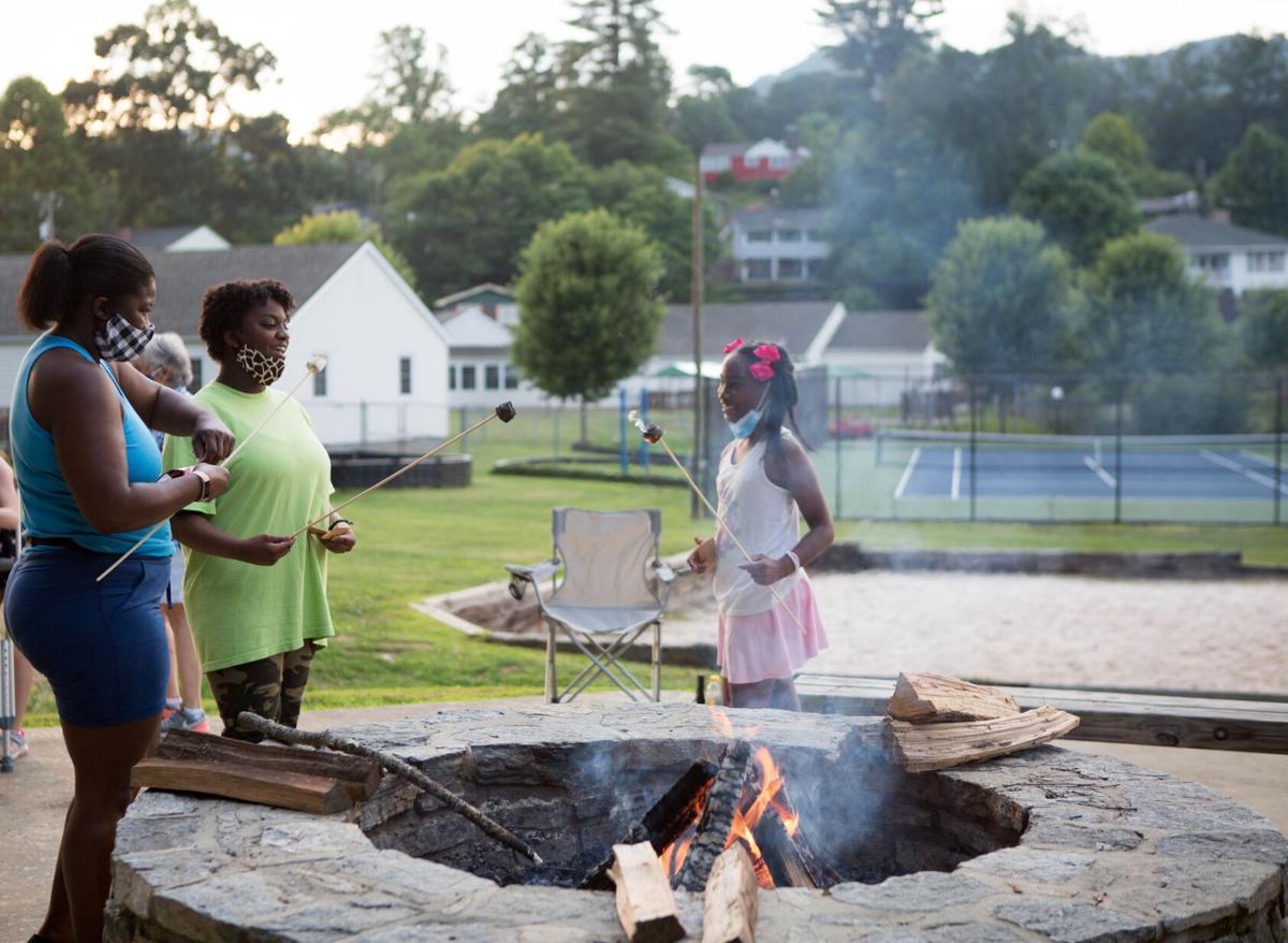 Lake Junaulska bonfire(L - R) Regina Knox, Alana Knox and Jada Mason create memories while making s'mores at the July 3 bonfire..jpg