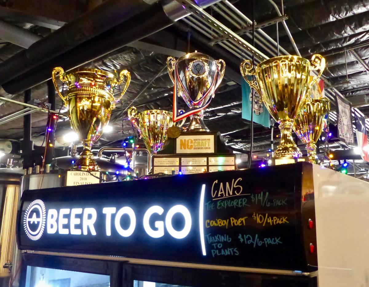 Archetype Brewing's accolades: NC Brewers Guild 2018 Best of Show cup in center