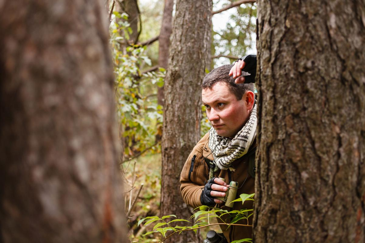 Man with binoculars at a forest
