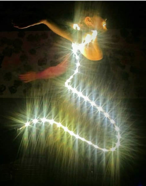 Angel-of-Light-performance-art-471x600.jpg