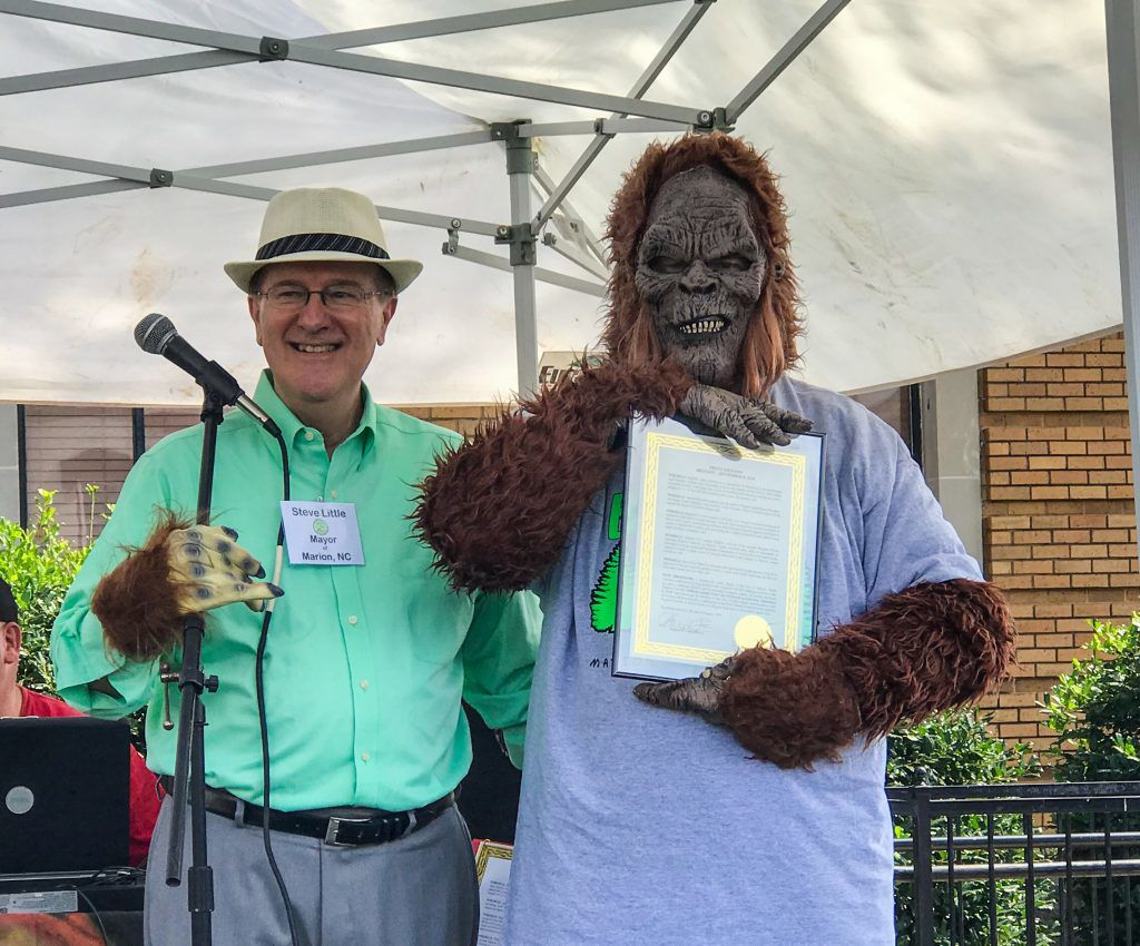 Mayor Steve Little with the Proclamation making Bigfoot Marion's Official Animal.jpg