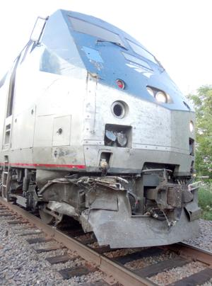 TRAIN/TRUCK ACCIDENT MONDAY SENT DRIVER TO ST. LOUIS HOSPITAL