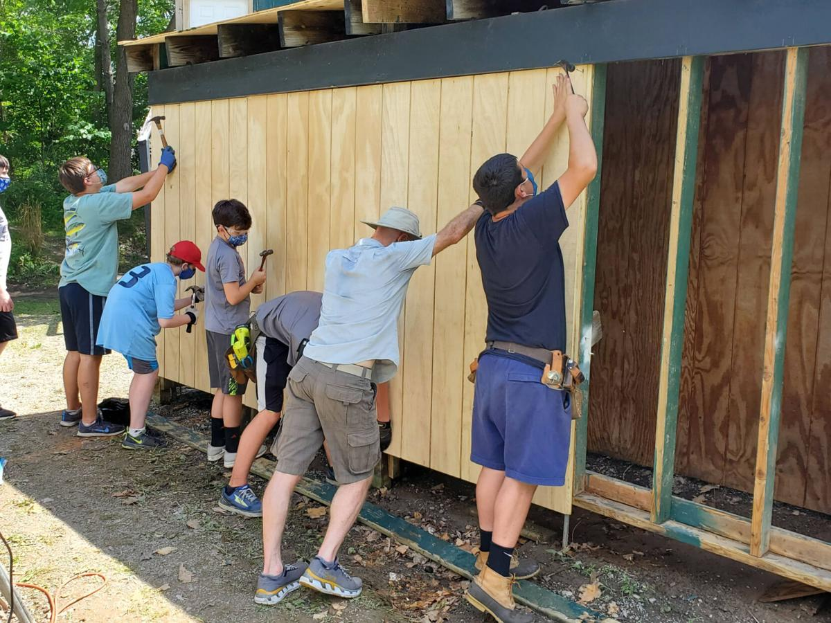 Scouts team up to rebuild dugouts