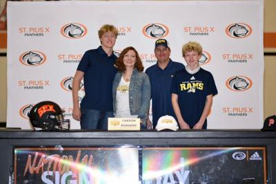 High school athletes sign to play at colleges