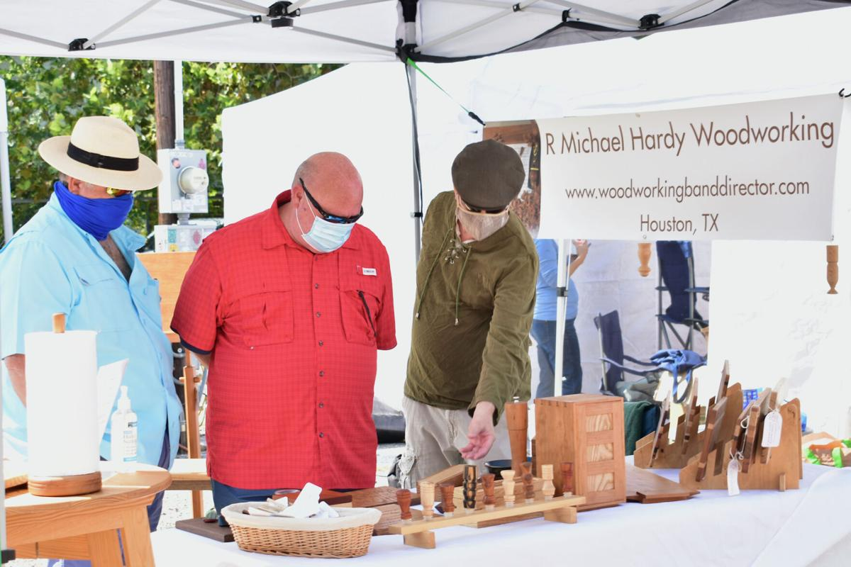 R. Michael Hardy, right, at First Saturday Arts Market – photo by Ana Guzman