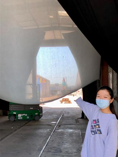 Fuko Nara shows where her code work turned animation will be presented [in the Train Shed at Sawyer Yards.].jpeg