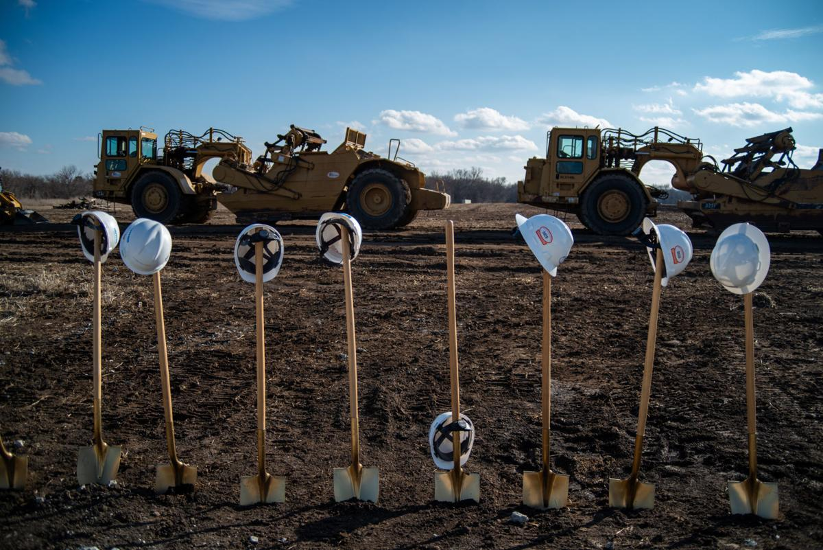 Hard hats hang on shovels at the Oliver Brown Elementary School construction site.