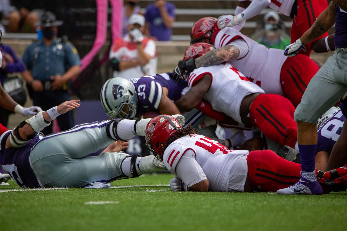 The Arkansas State players piles onto of Tyler Burns, senior running back. The Kansas State Wildcats faced off against Arkansas State wolves on Saturday at Bill Snyder Family Stadium, Arkansas State beat Kansas State 35 to 31.