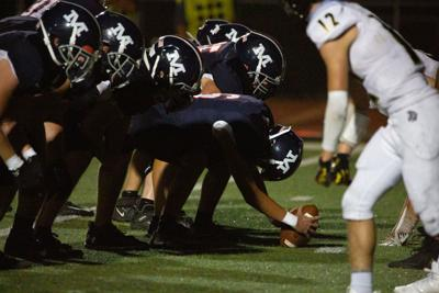 Offensive line waits for play start looking forward into Topeka High. Friday night Manhattan High School played against Topeka High winning 42-6.