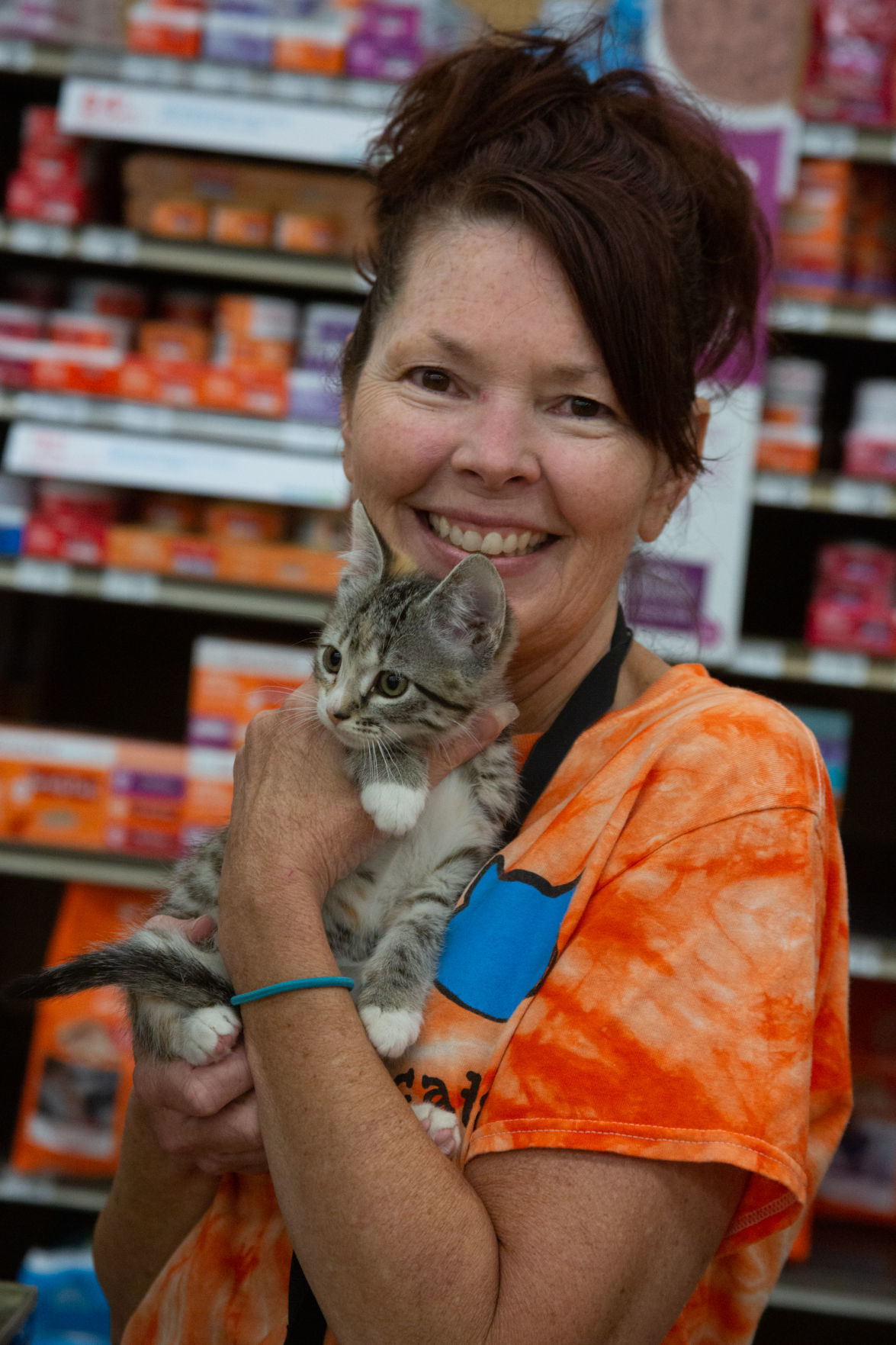 Natalie Young holds Cupcake who is up for adoption at Petco.