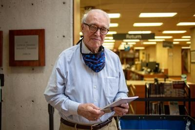 """Retired archivist Tony Crawford is shown holding the book """"Life Shards: Poems"""" on Wednesday at the Public Library."""