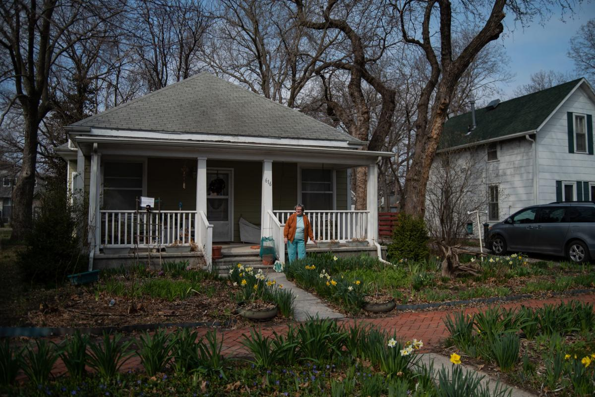 """Mary Jo Harbour stands in her front yard on her 84th birthday as Scott Freeby plays her """"Happy Birthday"""" with his trumpet from his car on Tuesday."""