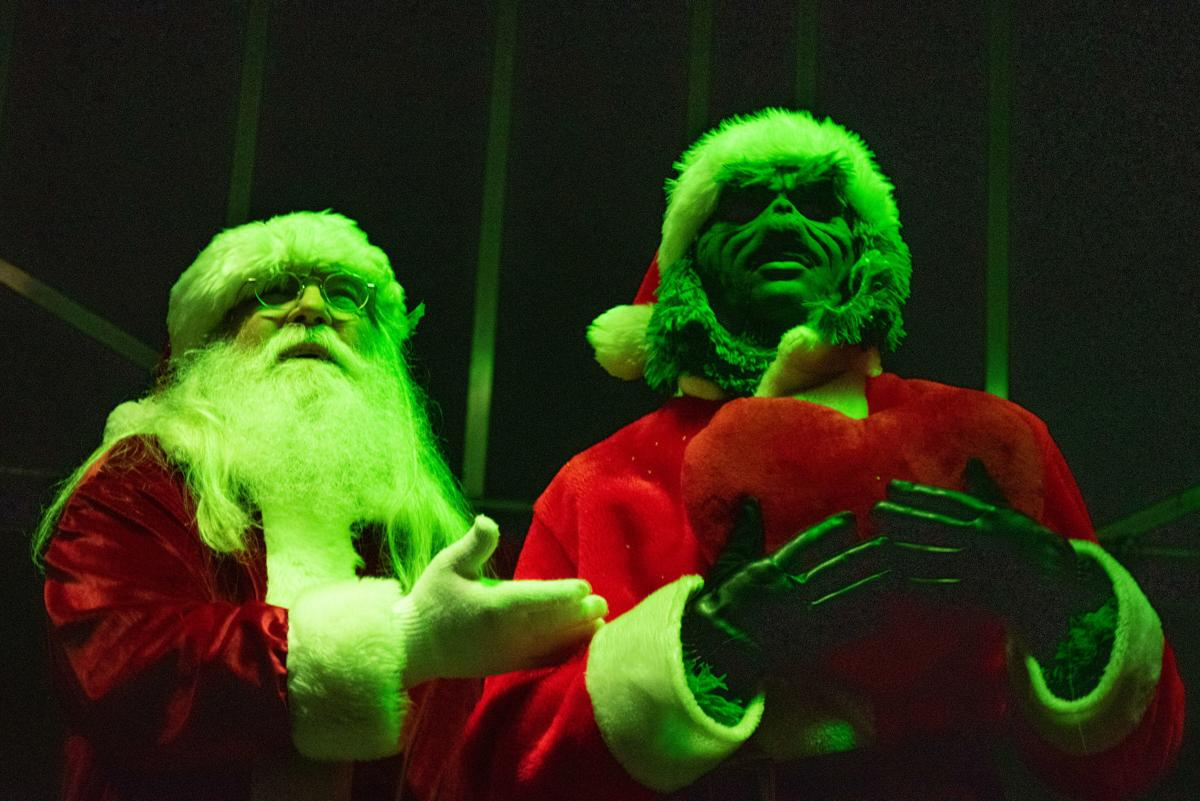 Santa Claus makes peace with the Grinch and lets him turn on the lights to the Christmas tree