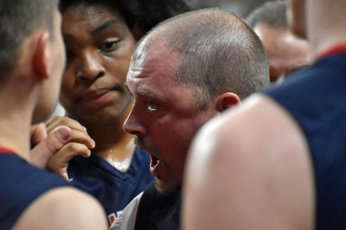Manhattan coach Benji George talks to his team