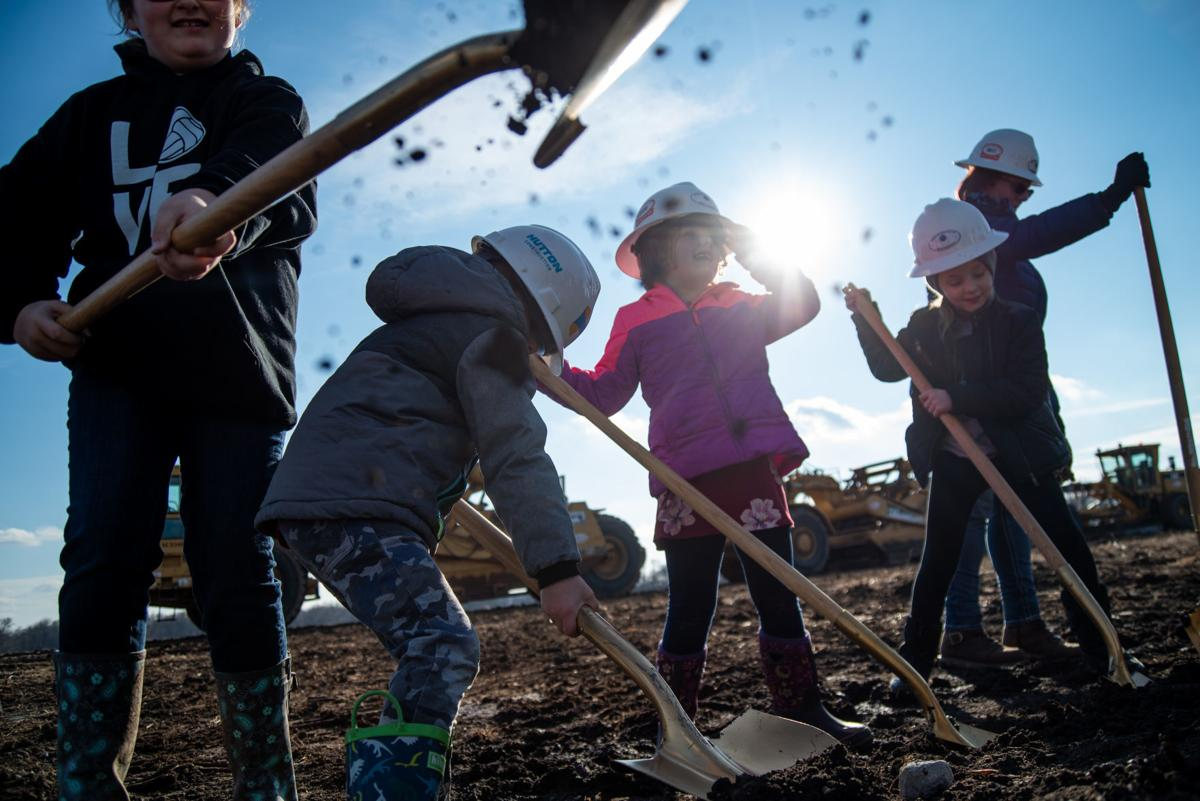 From left, Morgan Roberts, 9, Josh Fund, 5, Taylor Roberts, 6, and Cameryn Aggson, 9, shovel dirt at the Oliver Brown Elementary School ground breaking.