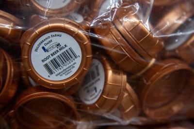 "Packs of lids labeled ""Root Beer Milk"" at Hildebrand Farms."