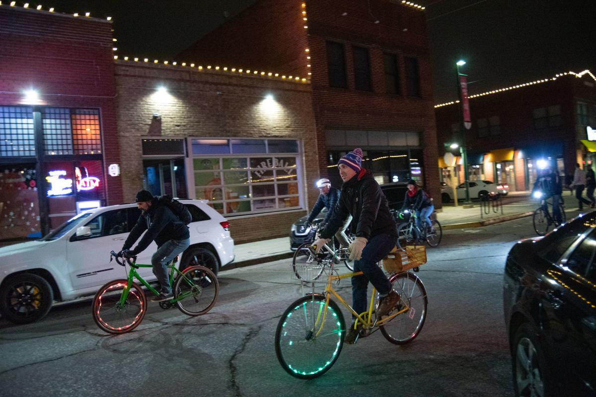From the left, Ron Orchard, Carsten Boschen, Jared Tremblay, Emily Kohlhepp and Bill Pryor ride their bikes down Moro Street during the Final Friday Slow Bike-Walk.