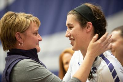 Peyton Williams (11) shares a moment with K-State head coach Suzie Fritz