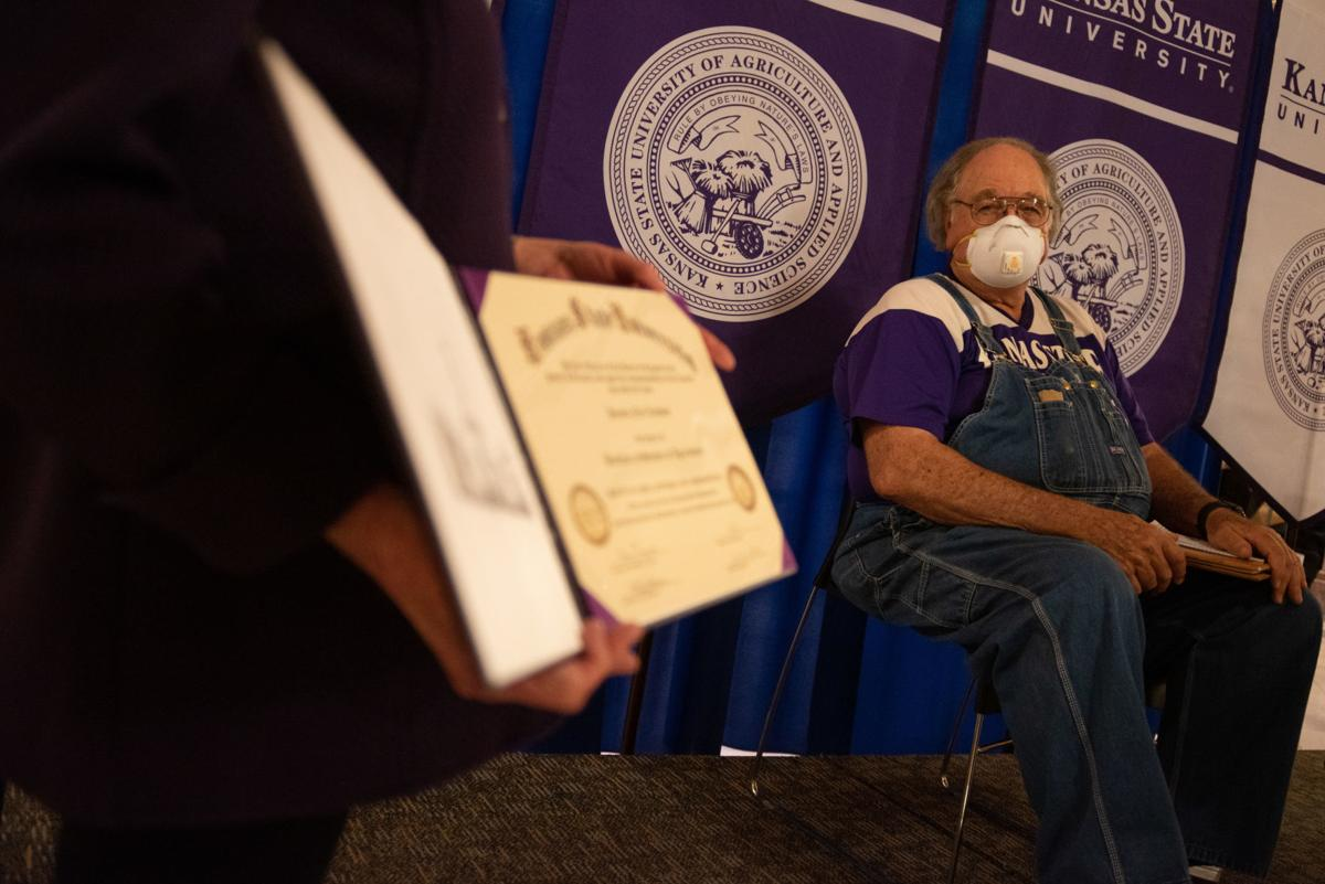 Governor Laura Kelly presents Dennis Ruhnke his degree of Bachelor of Science in Agriculture from K-State University at the Kansas State Capitol in Topeka.