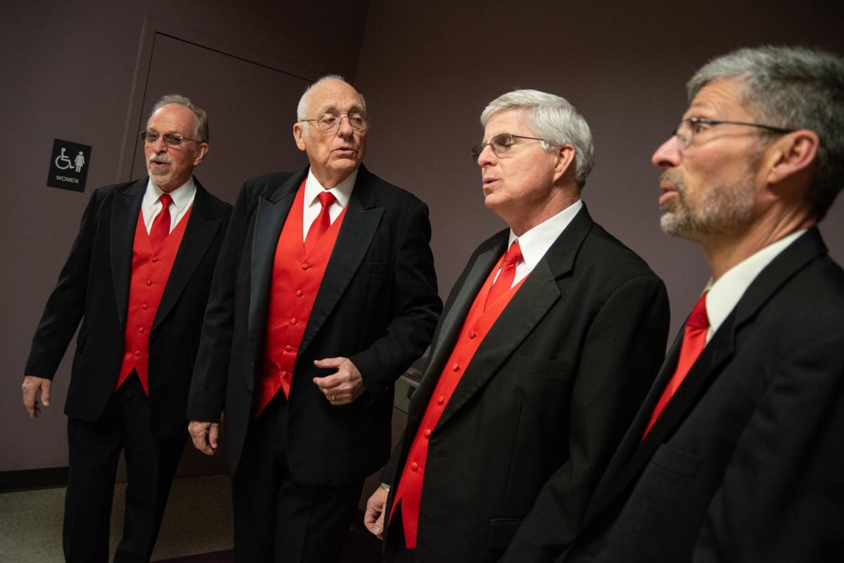 From left, Ken Garwick, Leonard Purvis, Steve McKinzie and Tom Fish practice a ValentineÕs song before singing for the recipient of the Singing Valentine.