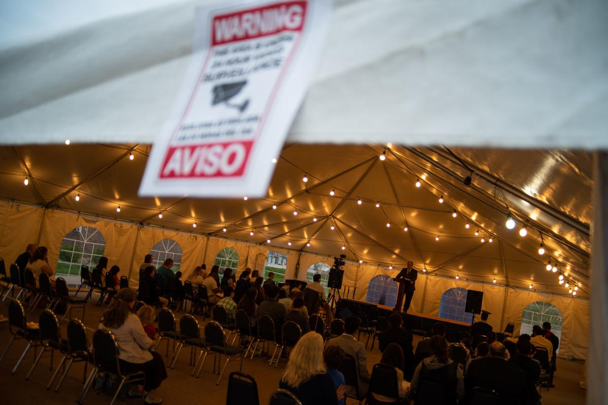 A surveillance sign hangs on the tent at Harvest Baptist Church after the tent and church bus were vandalized on Monday night. The tent is on loan from Berrean Baptist Church in Wichita, Kansas.