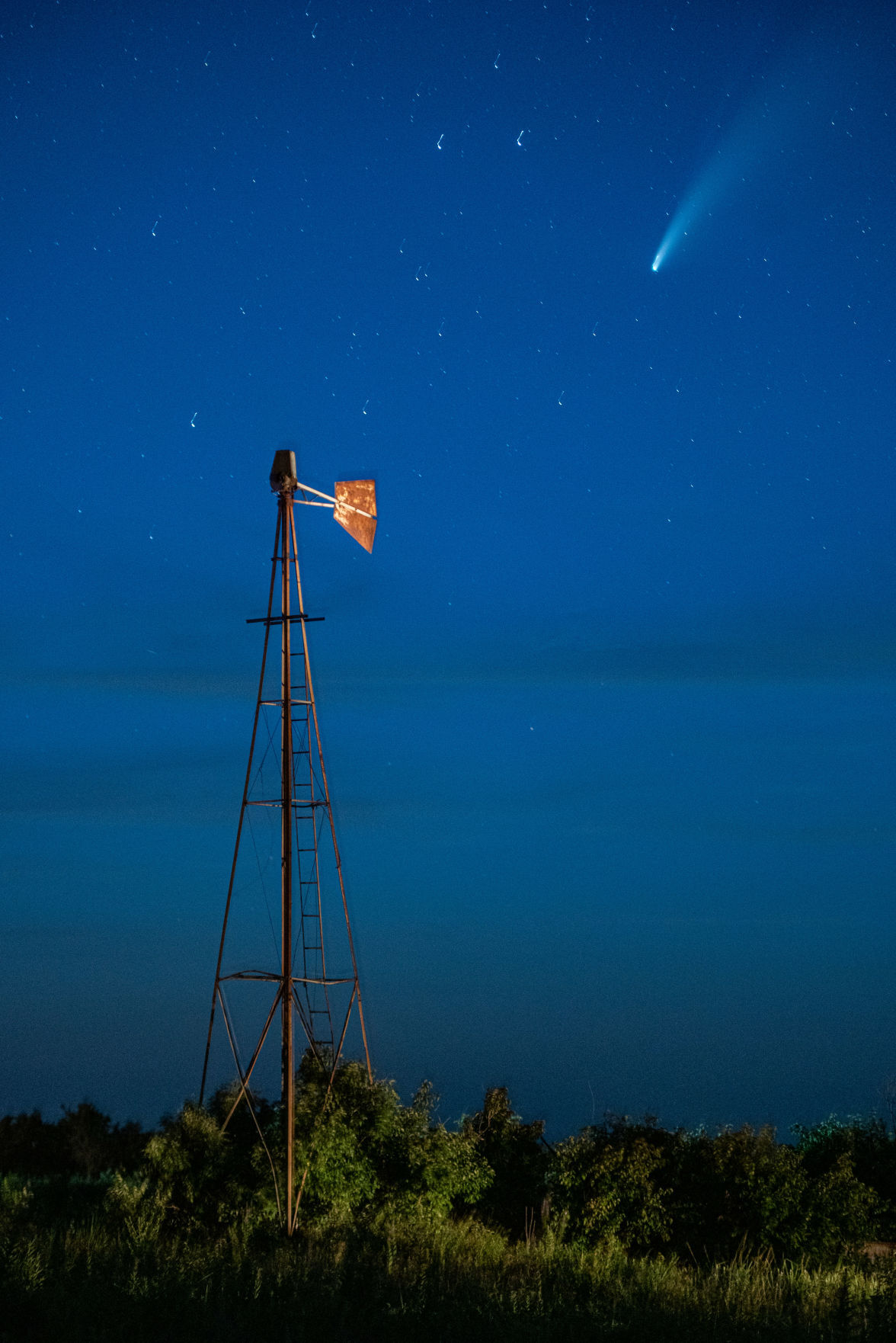 Comet NEOWISE or C/2020 F3 flies above a windmill just north of Highway 16 on Shannon Creek Road at 10:23 p.m. The comet was first identified by the infrared-optimized NEOWISE spacecraft (short for Near-Earth Object Wide-field Infrared Space Explorer) on March 27, 2020 and will be visible to the naked eye until the end of July 2020. Comet NEOWISE can be found under the Big Dipper when looking in the Northwest direction. Comet NEOWISE is traveling at a speed of 17,500 miles per hour and wonÕt be visible for another 6,800 years.