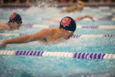 Chris Bedros competes in the 100 yard butterfly.