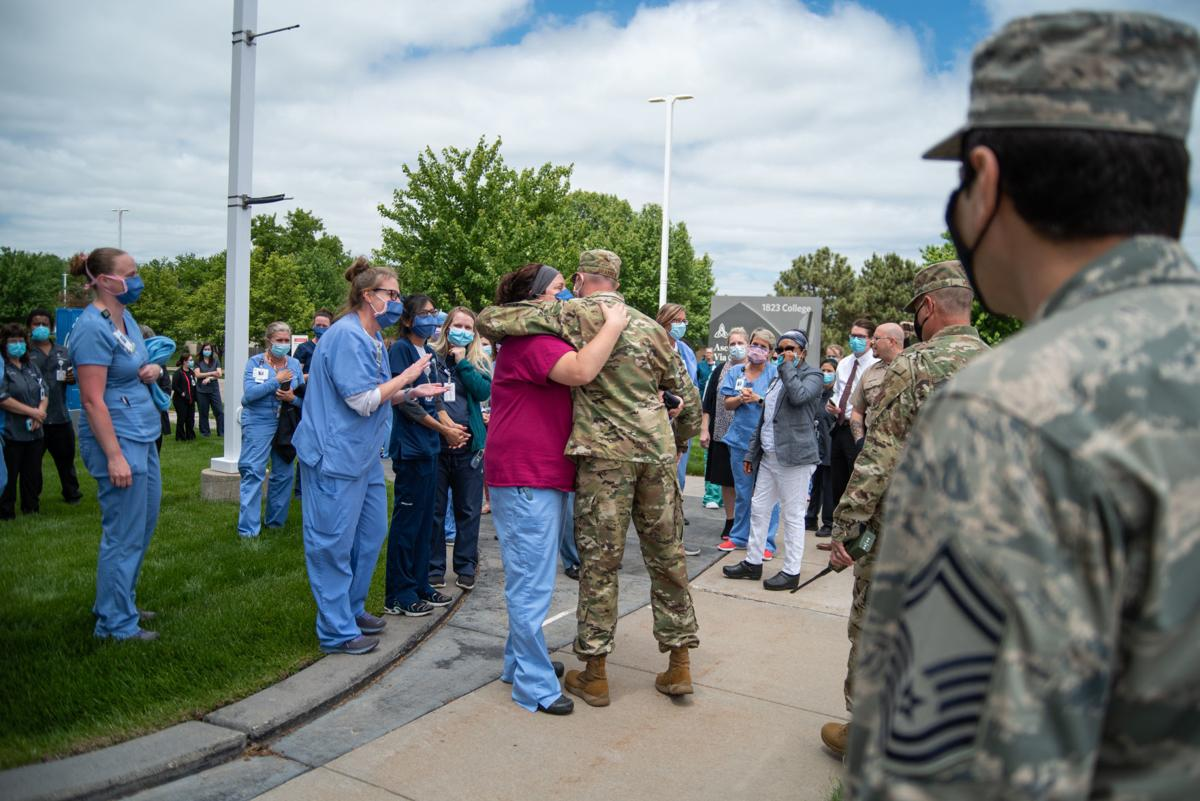 Senior Master Sergeant Wally Brannen hugs Melanie Hastert outside of Ascension Via Christi Hospital after the National GuardÕs 190th Air Refueling Wing flew over the hospital on Tuesday. The mission was titled Operation Kansas Strong and was a salute to healthcare and frontline workers affected during the coronavirus pandemic.