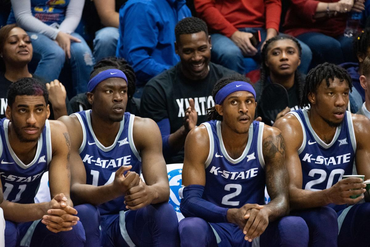 Antonio Brown (11), Makol Mawien (14), Cartier Diarra (2) and Xavier Sneed (20) sit on the bench and watch their team during the second half