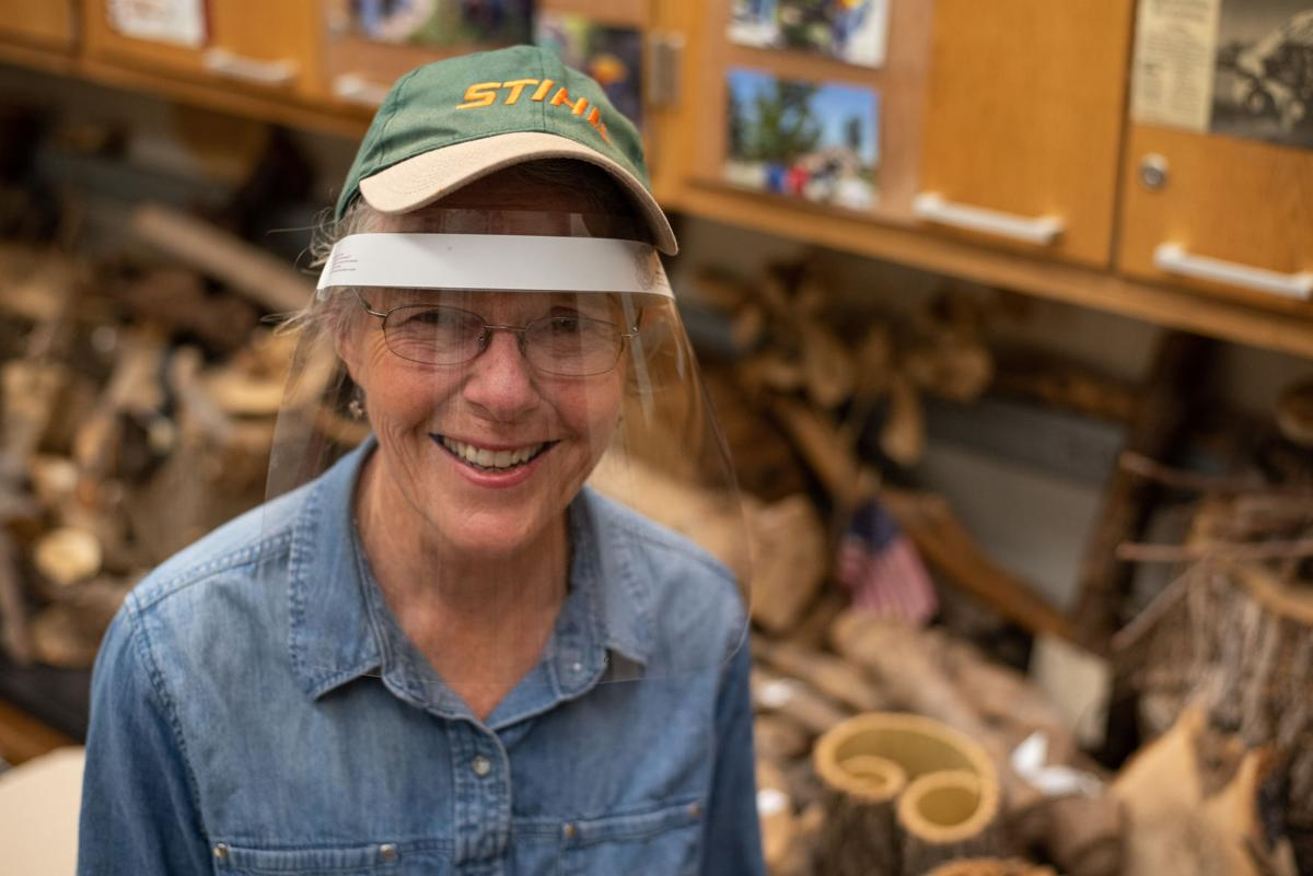 Cathie Lavis sits on a table in her classroom in Throckmorton Plant Sciences Center on Wednesday.