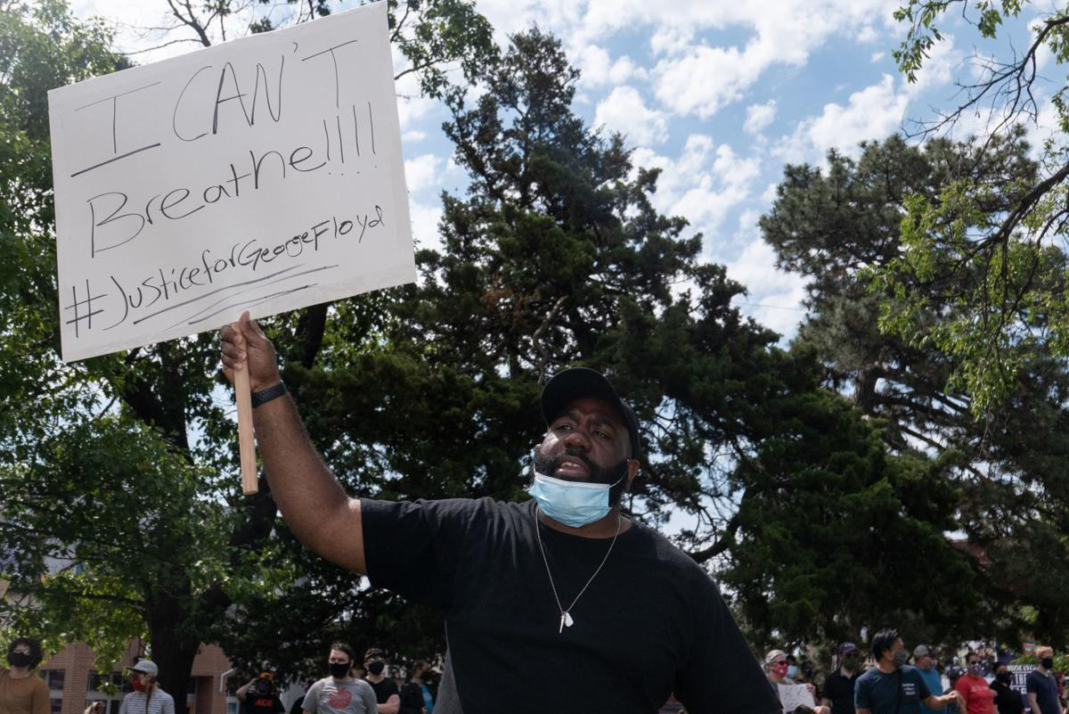 Trumanue Lindsey Jr. holds a sign that reads, ÒI CanÕt Breathe #JusticeforGeorgeFloydÓ while at the peaceful protest in honor of George Floyd at Triangle Park on Saturday.