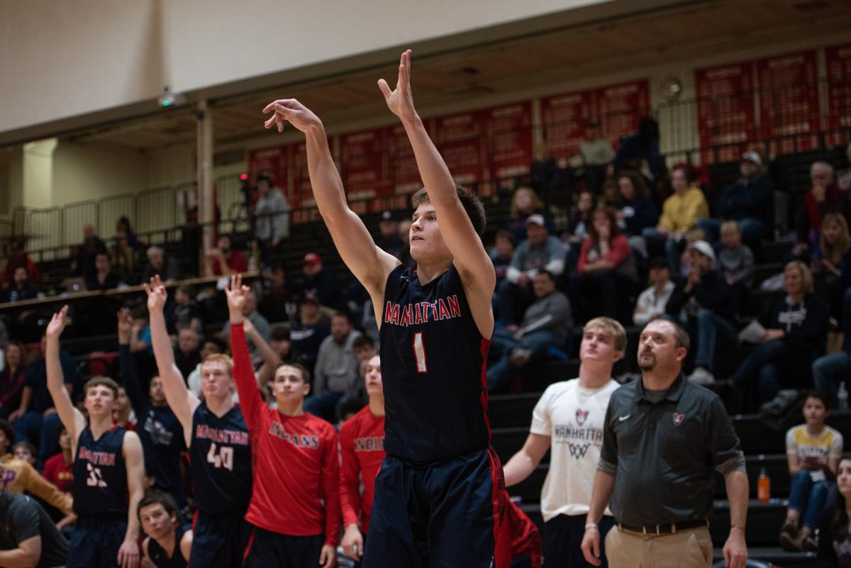 Peyton Weixelman (1) shoots a three-pointer in front of his teamÕs bench and makes it as time winds down in the fourth quarter.