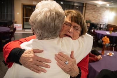 Linda Morse hugs Carolyn Roberts