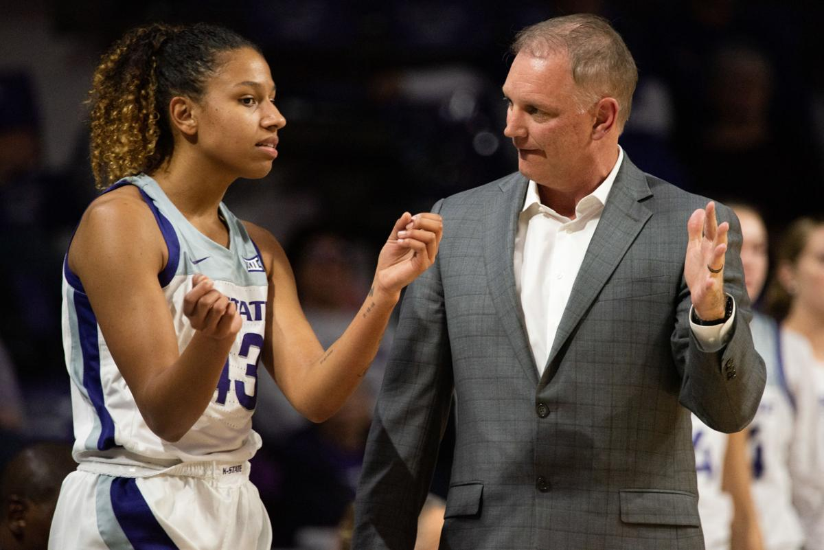 Christianna Carr (43) talks with K-State head coach Jeff Mittie on the sideline during the first quarter.