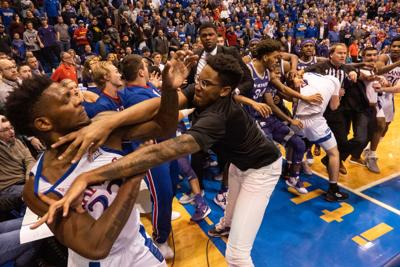 Silvio De Sousa (22) gets into a scuffle with James Love III after De Sousa walked over David Sloan (4) at the end of the game.