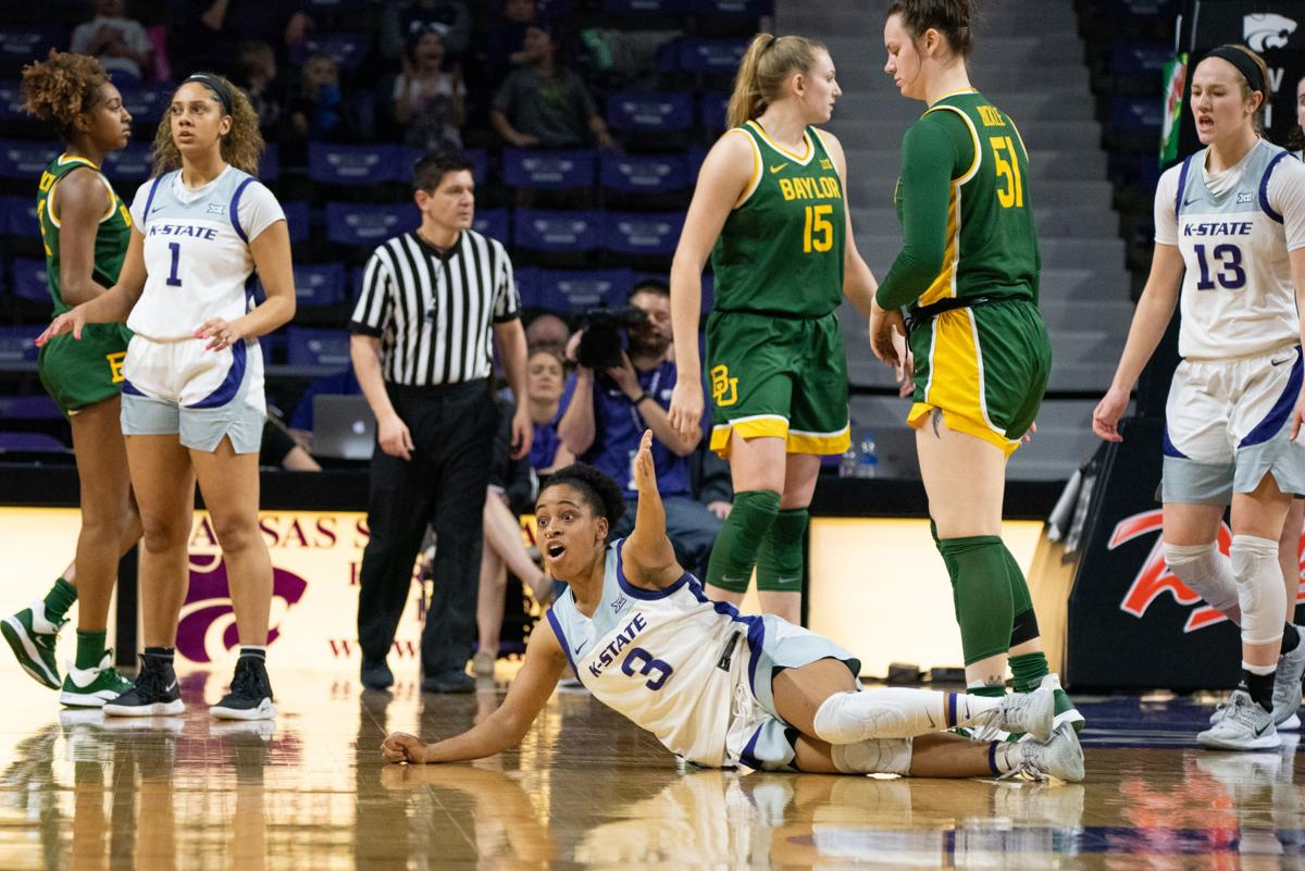 Angela Harris (3) looks at the referee for a foul to be called.