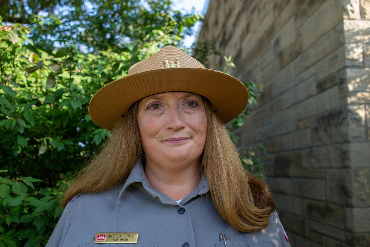 Angelia Lentz, park ranger, smiles outside of office. Her favorite aspect of her job is educational programs in the community such as water safety and the history of the lake.