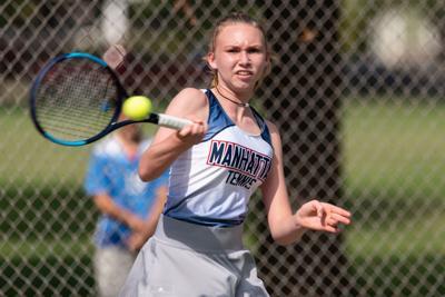Jill Harkin returns a serve