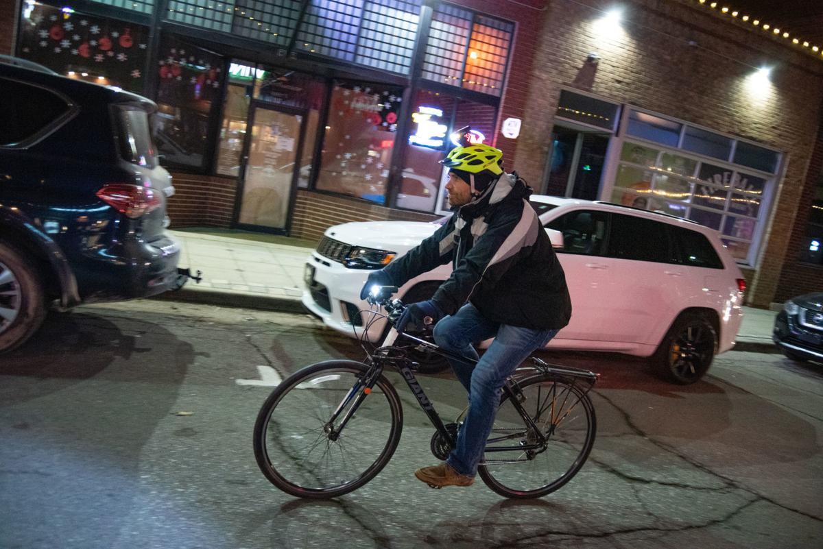 Bill Pryor rides his bike down Moro Street during the Final Friday Slow Bike-Walk.