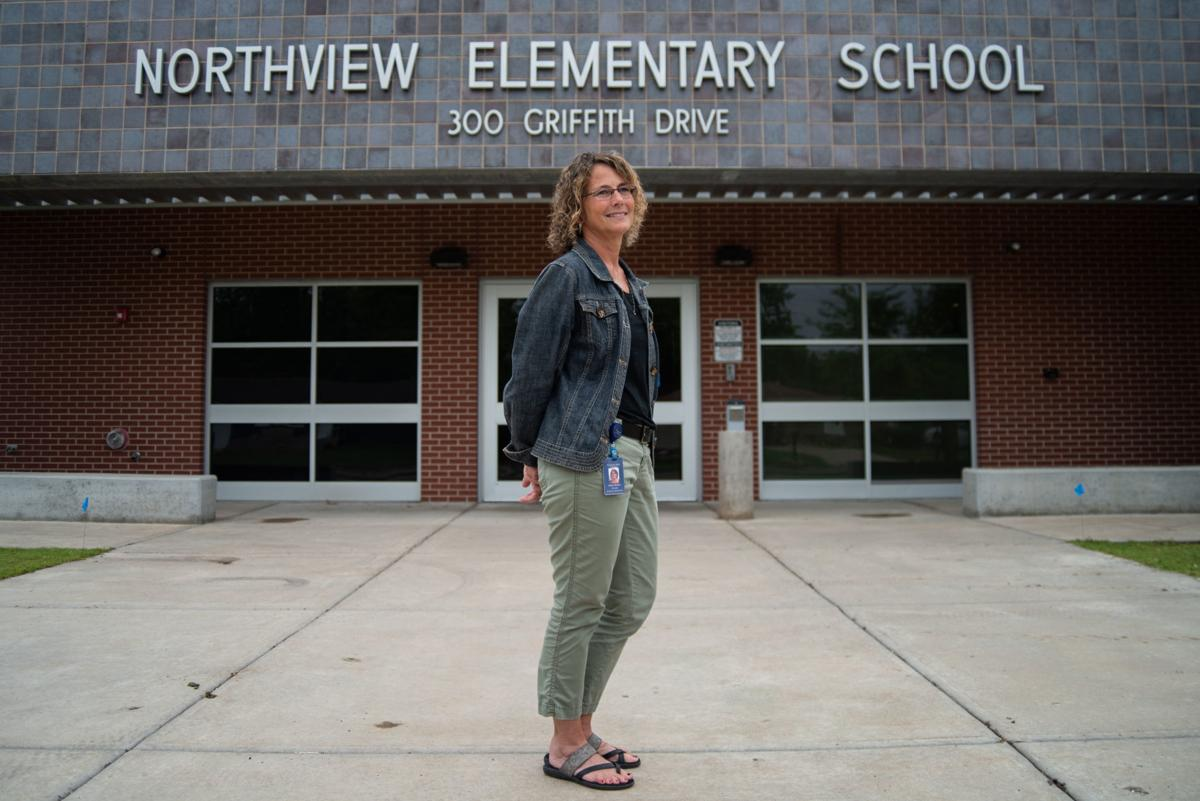 Dr. Cleion Morton stands in front of Northview Elementary School on Friday.