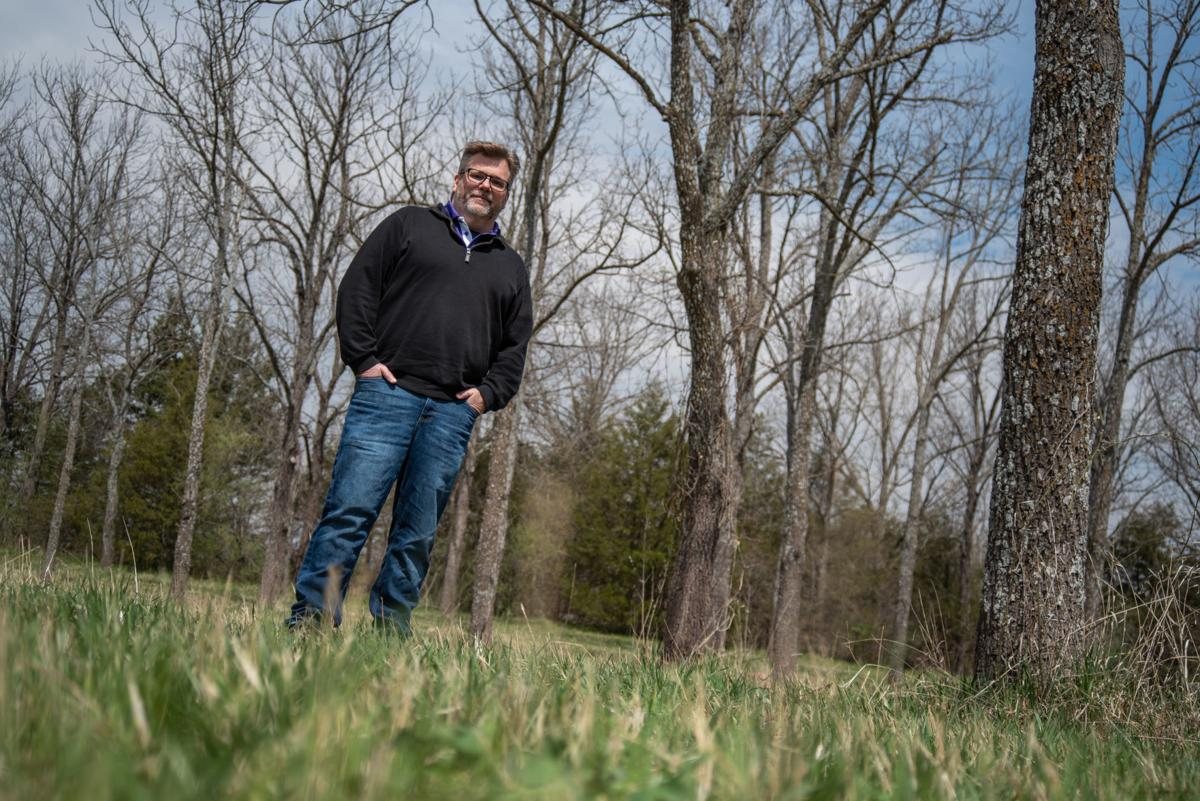 Jeremy Marshall, Entomology Professor at K-State, stands in between the trees at Wildcat Park on Saturday.
