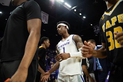 Shuan Williams high-fives Arkansas-Pine Bluff's basketball team after the game